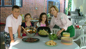 Photo of Dame Carla Snyder with Jr. Chefs